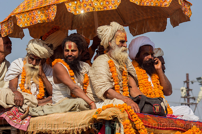 hindu gurus and babas on their float - kumbh mela (india), float, gurus, hindu pilgrimage, hinduism, india, kumbh maha snan, maha kumbh mela, mauni amavasya, men, parade, umbrella
