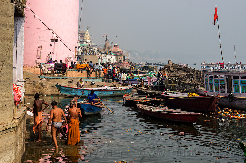 hindu holy bath in ganga river - ghats of varanasi (india), ganga river, ganges river, ghats, hindu, hinduism, holy bath, holy dip, mooring, pink tower, river bath, river bathing, river boats, varanasi, water tower