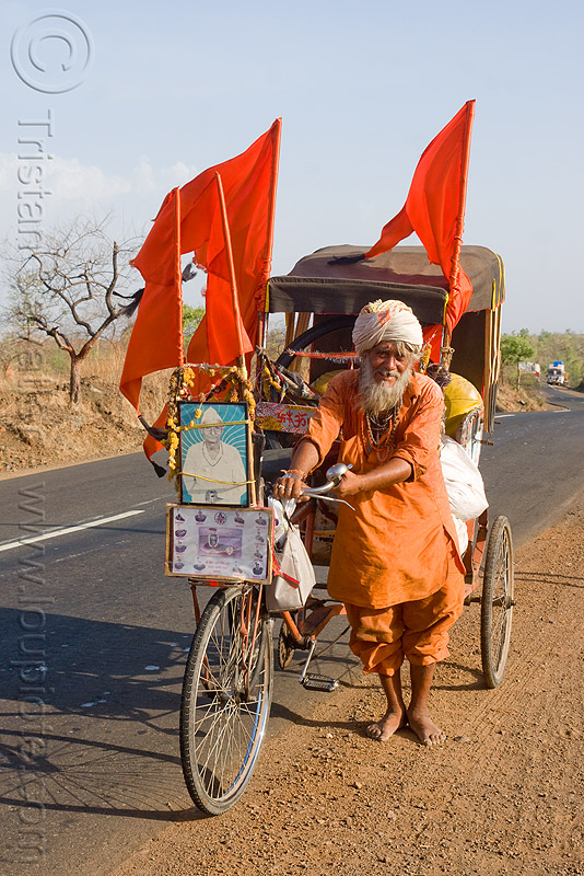 hindu pilgrim on cycle rickshaw (india), amarnath yatra, bare feet, barefoot, flags, man, old man, people, red flags, road, tricycle, yatri