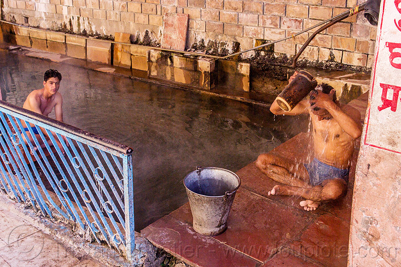 hindu pilgrims bathing at the surya kund pool - yamunotri sacred hot springs (india), bath, bathing, cross-legged, divya shila, hot springs, india, men, metal bucket, pool, pucket, shower, showering, sitting, surya kund, yamunotri