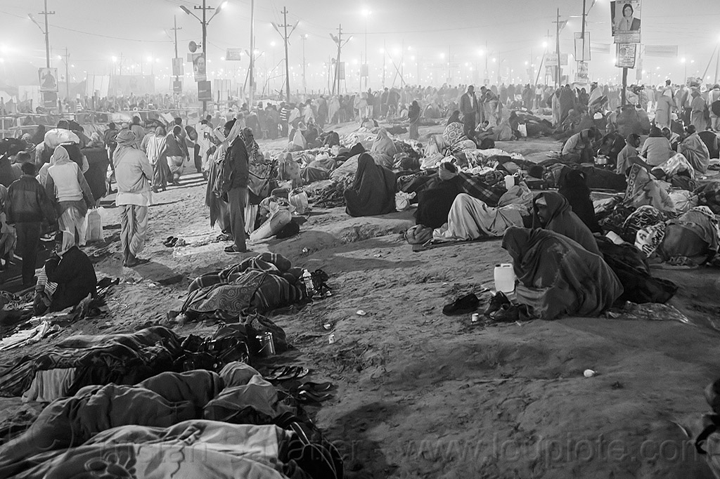 hindu pilgrims camping in the street at night - kumbh mela (india), camping, crowd, hindu pilgrimage, hinduism, india, kumbh maha snan, maha kumbh mela, mauni amavasya, night, sleeping, triveni sangam, walking