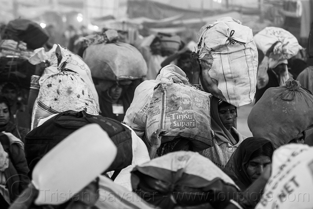 hindu pilgrims carrying bags over their heads - kumbh mela (india), bags, bundles, carrying on the head, exodus, hindu, hinduism, kumbha mela, luggage, maha kumbh mela, men, night, street, walking, women