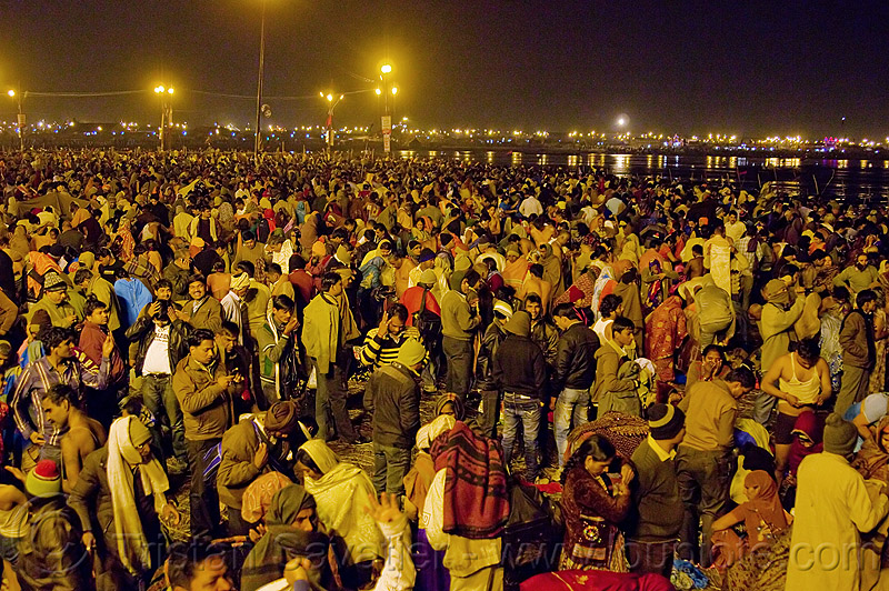 hindu pilgrims gathering at sangam for the holy bath in the ganges river - kumbh mela 2013 (india), crowd, hindu pilgrimage, hinduism, india, maha kumbh mela, men, night, paush purnima, pilgrims, street lights, triveni sangam, women