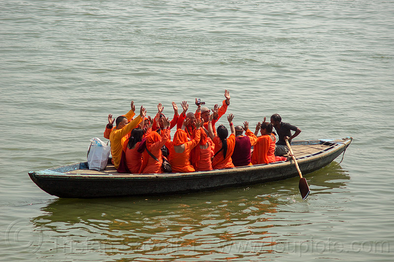 hindu pilgrims on boat on the ganges river, waving hands (varanasi), bhagwa, ganga river, ganges river, hands, hindu, hinduism, orange color, pilgrims, river boat, rowing boat, saffron color, small boat, varanasi, water, waving