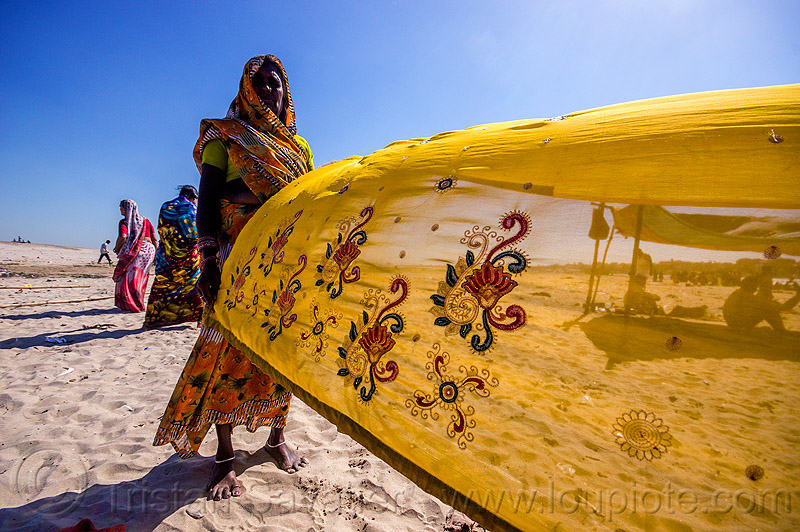 hindu woman drying sari in the wind - varanasi (india), beach, drying, sand, saree, sari, varanasi, wind, woman, yellow