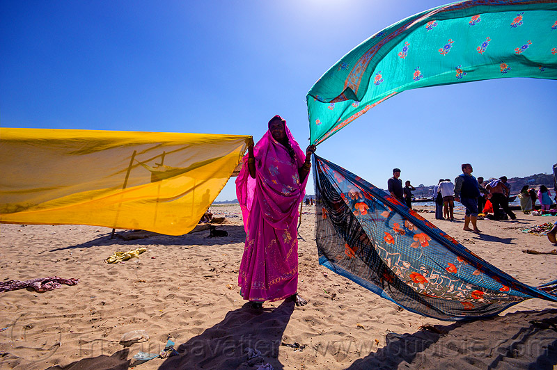 hindu woman drying saris in the wind after holy bath in the ganges river - varanasi (india), beach, drying, river bank, sand, saree, sari, varanasi, wind, woman