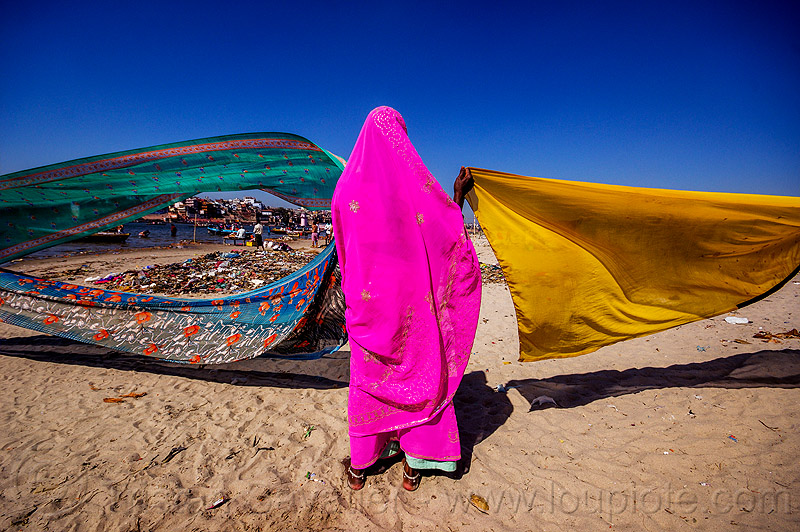 hindu woman drying saris in the wind - varanasi (india), beach, drying, river bank, sand, saree, sari, varanasi, wind, woman