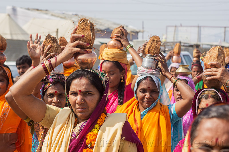 hindu women carrying coconut offerings (india), carrying on the head, coconut offerings, coconuts, crowd, hindu, hinduism, kumbha mela, maha kumbh mela, walking, women
