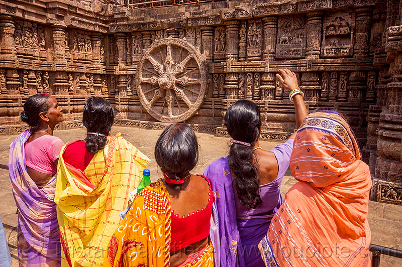 hindu women looking at ancient erotic carvings - konark sun temple (india), carving, erotic sculptures, high-relief, hindu temple, hinduism, konark sun temple, maithuna, sarees, saris, stone wheel, women