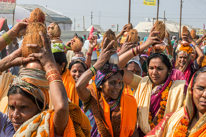hindu women with coconut offerings over their heads (india), carrying on the head, coconut offerings, coconuts, crowd, hindu, hinduism, kumbha mela, maha kumbh mela, walking, women