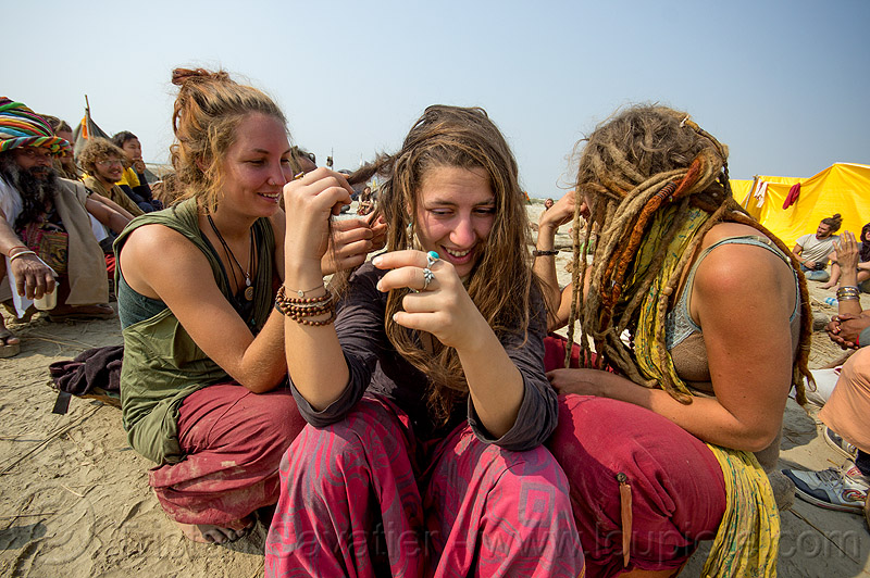 hippie girls making dreadlocks hair, hippies, kumbh mela, kumbha mela, maha kumbh, maha kumbh mela, people, rainbow camp, sitting, woman
