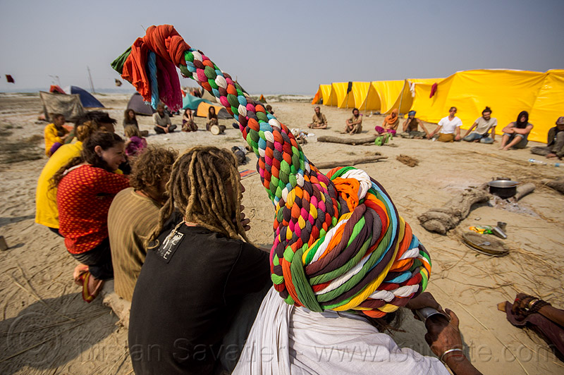hippie hat - rainbow camp - kumbh mela 2013, camp fire, camping, circle, crowd, hippies, kumbha mela, maha kumbh mela, pointy hat, rainbow camp, rainbow colors, sitting, tents