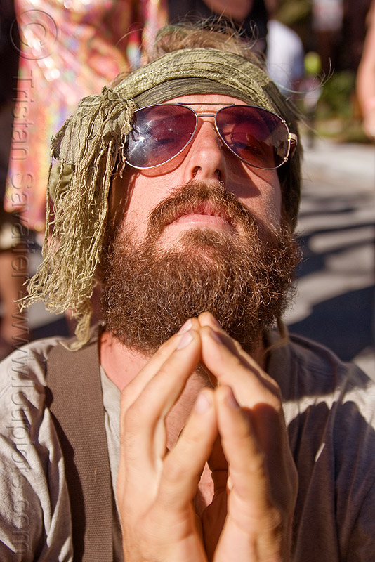hippie man praying, burning man decompression, head band, henry, hippie, praying, scarf, sunglassed
