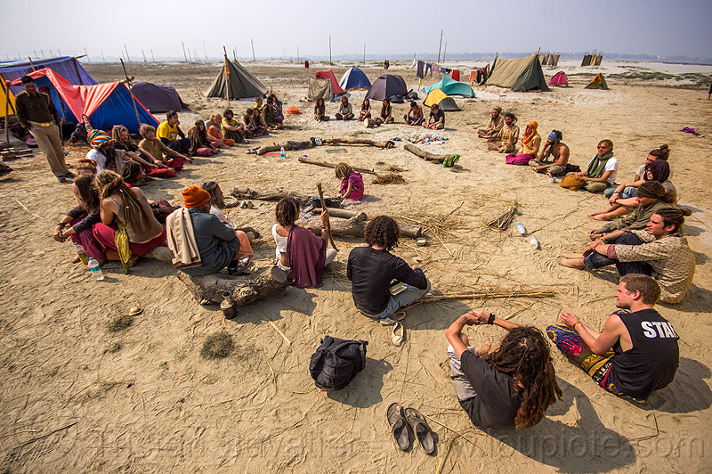 hippies sitting in circle at rainbow camp - kumbh mela 2013, camp fire, camping, circle, crowd, hippies, kumbha mela, maha kumbh mela, rainbow camp, sitting, tents