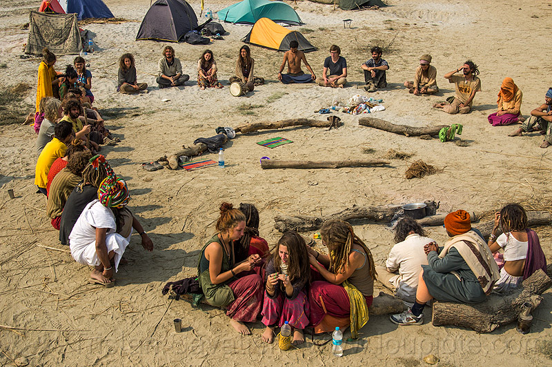 hippies sitting in supper circle at rainbow camp - kumbh mela 2013, camp fire, camping, circle, crowd, hindu pilgrimage, hinduism, hippie, india, maha kumbh mela, rainbow camp, sitting, tents