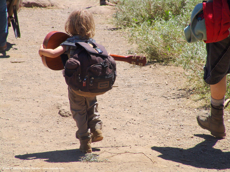 hippy-kid-with-ukulele - rainbow gathering - hippie, backpack, boy, child, guitar, hippie, kid, rainbow family, rainbow gathering, ukulele