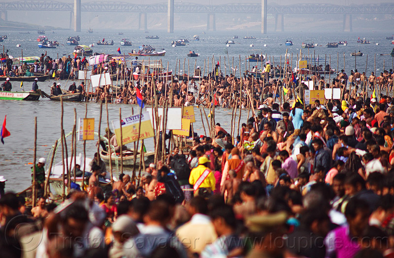 holy bath in ganges river at triveni sangam - kumbh mela 2013 (india), bathing, boats, crowd, dawn, fence, ganga, ganga river, hindu, hinduism, holy dip, kumbha mela, maha kumbh, maha kumbh mela, paush purnima, people, pilgrims, ritual bath, river bank, river bath, river bathing, river boats, water, yatris