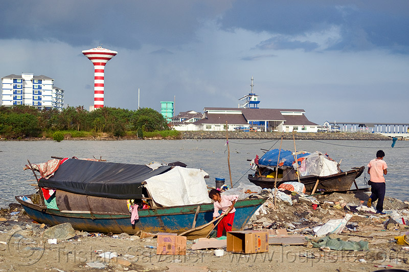 homeless living on boats, encampment, garbage, homeless camp, lahad datu, ocean, people, poor, rubbish, sea, seashore, shore, small boats, trash, wasteland, water tower