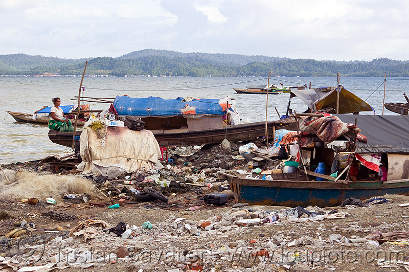 homeless living on boats, encampment, environment, garbage, homeless camp, lahad datu, ocean, plastic trash, pollution, poor, rubbish, sea, seashore, shore, small boats, wasteland