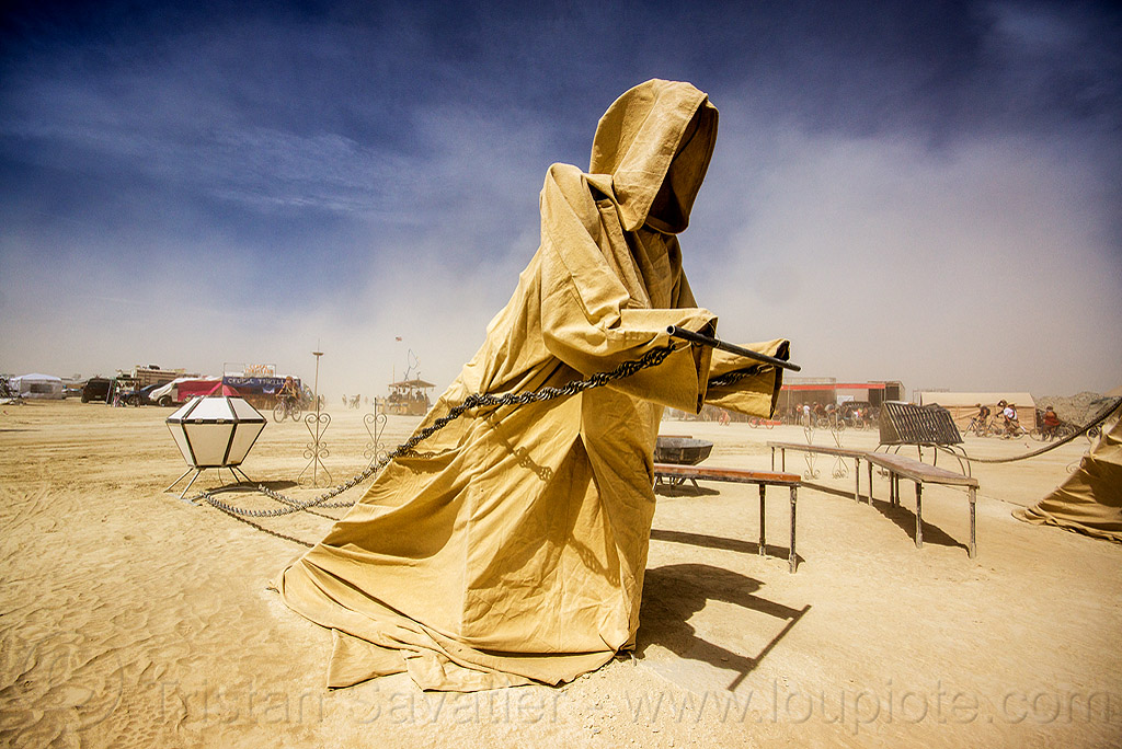 hooded figure pulling chains - well of darkness - burning man 2015, art, art installation, cape, chain, hood, iron monkeys, sculpture, statue