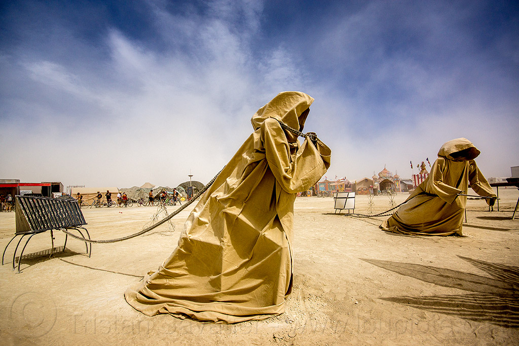 hooded figures pulling chains - well of darkness - burning man 2015, art installation, burning man, cape, chain, hood, hooded, iron monkeys, pulling, sculpture, statue, well of darkness