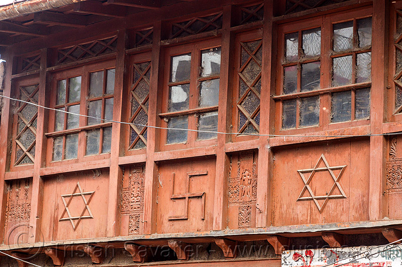 house with hindu symbols - shatkona (star of david) and swastika (india), almora, carved, facade, hexagram, hinduism, house, india, low relief, shatkona, star of david, swastika, symbols, windows, wood carving, wooden