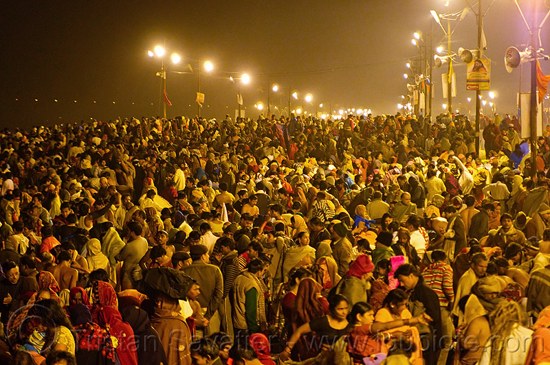 huge crowd of hindu pilgrims gathering at sangam for the holy bath in the ganges river - kumbh mela 2013 (india), crowd, hindu pilgrimage, hinduism, india, maha kumbh mela, men, night, paush purnima, pilgrims, street lights, triveni sangam, women
