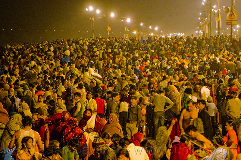huge crowd of hindu pilgrims near sangam - kumbh mela 2013, hinduism, kumbha mela, maha kumbh, maha kumbh mela, men, night, paush purnima, people, street lights, triveni sangam, women, yatris