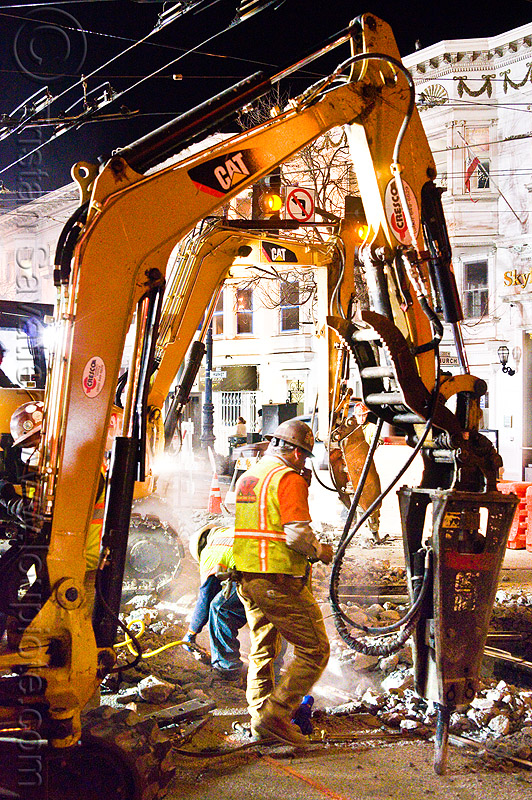 hydraulic jackhammers - muni railway construction site (san francisco), at work, attachment, demolition, excavators, high-visibility jacket, high-visibility vest, hydraulic jackhammer, light rail, man, muni, ntk, overhead lines, railroad construction, railroad tracks, railway tracks, reflective jacket, reflective vest, safety helmet, safety vest, san francisco municipal railway, track maintenance, track work, worker, working