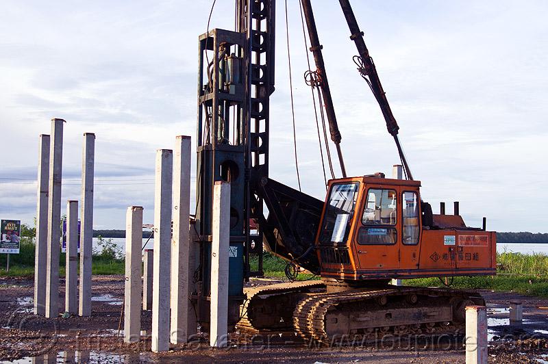 hydraulic pile driver, at work, beluran, borneo, building construction, building foundations, columns, foundation works, groundwork construction, hydraulic hammer, malaysia, pile driver, pile driving, precast concrete piles, reinforced concrete, working