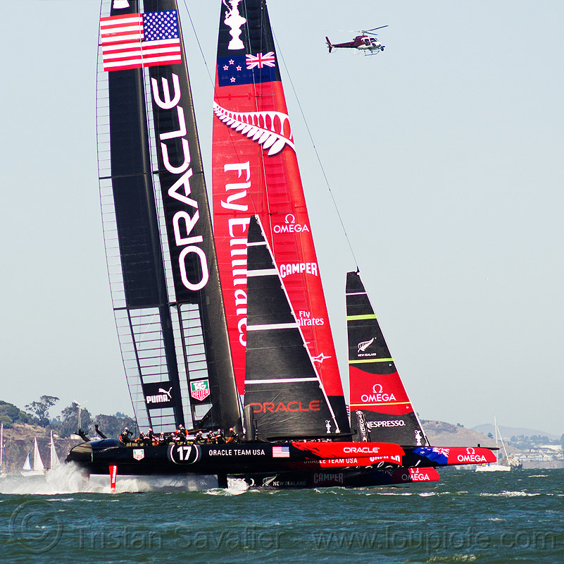 hydrofoil sailboats - neck and neck - america's cup 2013 race (san francisco), ac72, advertising, america's cup, bay, boats, catamarans, emirates team new zealand, fast, foiling, helicopter, hydrofoil catamarans, hydrofoiling, hydrofoils, ocean, oracle team usa, racing, sailboat, sailing, sailing hydrofoils, sea, ships, speed, sponsors, two, water