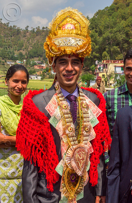 indian groom with ceremonial headwear and banknotes necklace (india), banknotes, groom, hat, headdress, india, indian wedding, man, money, necklace, standing, tola gunth, wedding costume