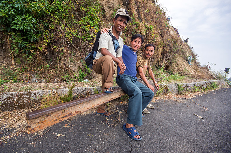 indian people near the darjeeling road landslide (india), broken, darjeeling, india, men, mountain road, rail, sitting, tindharia landslide
