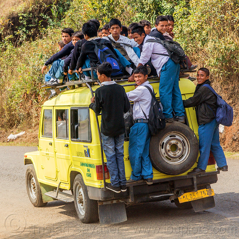 indian school bus - overloaded car (india), 4x4, boys, car, children, crowd, east khasi hills, india, indigenous, kids, mahindra maxx, meghalaya, nangkiew, overloaded, road, school bus, school jeep, shaphrang, yellow
