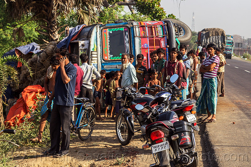 indian villagers around overturned truck (india), crash, crowd, india, lorry, motorcycles, overturned truck, road, rollover, tata motors, traffic accident, truck accident, truck driver, wreck