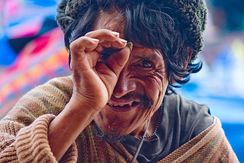 indigenous man looking through fingers (bolivia), hand, people, quechua, tarabuco
