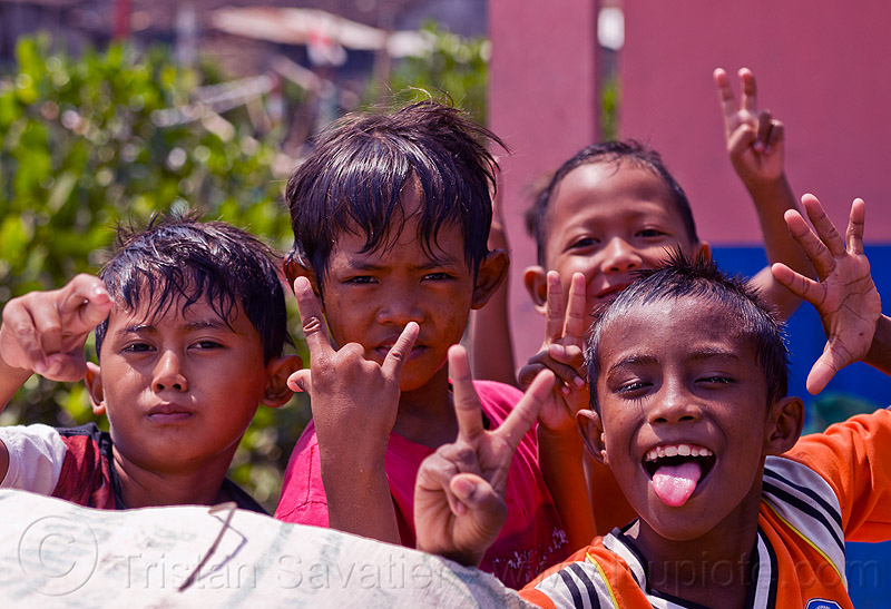 indonesian boys fooling around, boys, children, fingers, goofing, hand signs, hands, indonesia, kids, playing, sticking out tongue, sticking tongue out, tamansari