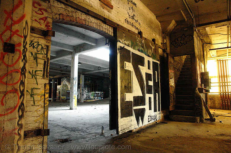 industrial sliding door, abandoned, abandoned factory, derelict, eskape, fire door, gate, graffiti, sliding gate, street art, tags, tie's warehouse, trespassing