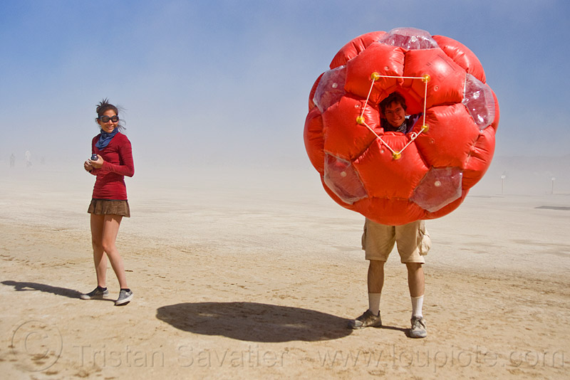 inflatable giant soccer ball, art installation, inflatable art, man, woman