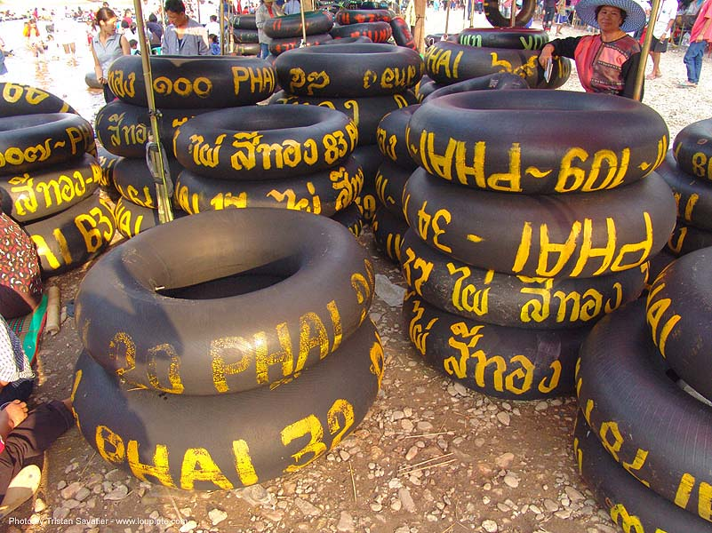 inner tubes with yellow paint markings - river tubing - thailand, fair, fang, inner tubes, river tubing, songkran, tha ton, thailand, สงกรานต์