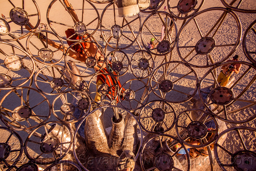 inside brainchild cage - burning man 2015, art, art installation, metal, michael christian, people, rings, sculpture