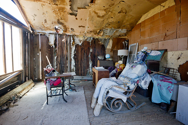 inside a dilapidated cabin - darwin ghost town, abandoned, cabin, darwin, death valley, desert, dilapidated, ghost town, interior, mannequin, peeling paint, puppet, rocking chair