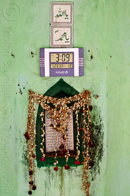 islamic shrine with LCD clock, altar, arabic, british residency, digital clock, flower strings, flowers, green wall, imambara, islam, lucknow, mahal, masjid, mosque, nawabi mahal, nawabi masjid, tiles, time, urdu, urdu script, urdu writing, wall clock