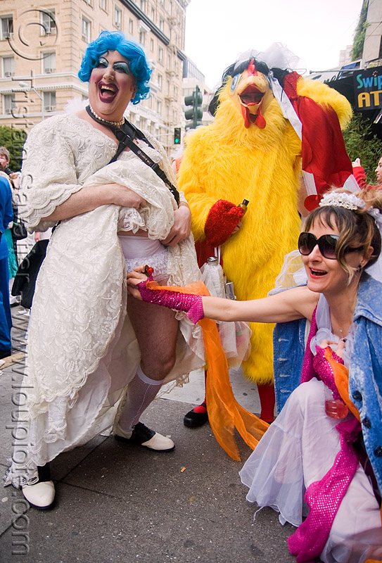 it's a boy! - man in drag getting check-out by a woman - brides of march (san francisco), blue hair, blue wig, bride, brides of march, chicken costume, man, palpation, wedding, white