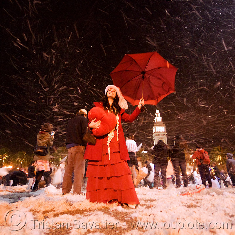 it's snowing in san francisco!, diana furka, down feathers, embarcadero clock tower, heart pillow, night, pillow fight club, pillows, red color, red umbrella, snow, snowing, woman, world pillow fight day