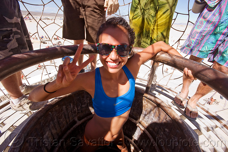 claudia in the access shaft of the minaret - burning man 2010, bryan tedrick, cage, love bug, love bugz, mas paz, peace sign, sunglasses, tower, v sign, woman