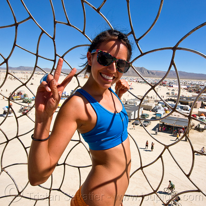 claudia sandivel garcia, bryan tedrick, burning man, cage, love bug, love bugz, mas paz, peace sign, people, sunglasses, the minaret, tower, v sign, woman