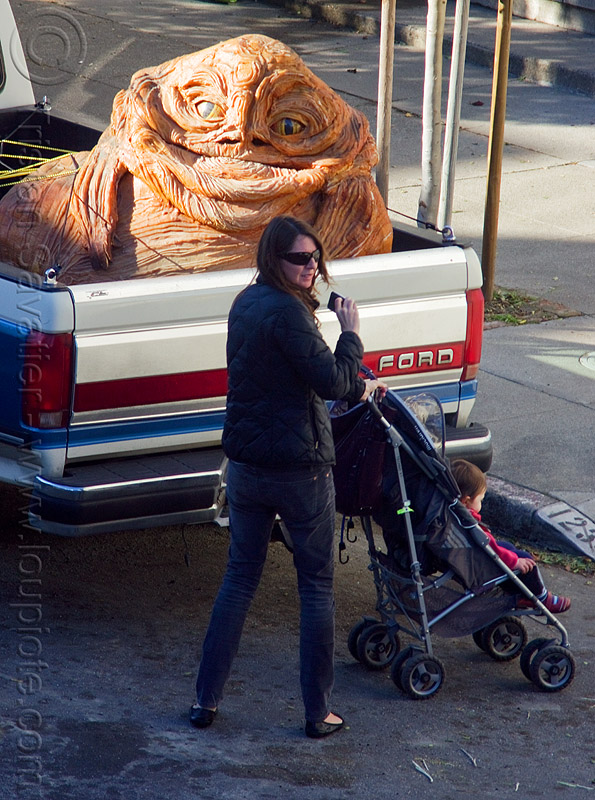 jabba the hutt in pickup truck, character, child, giant muppet, kid, people, special effects, starwars, street, stroller, woman