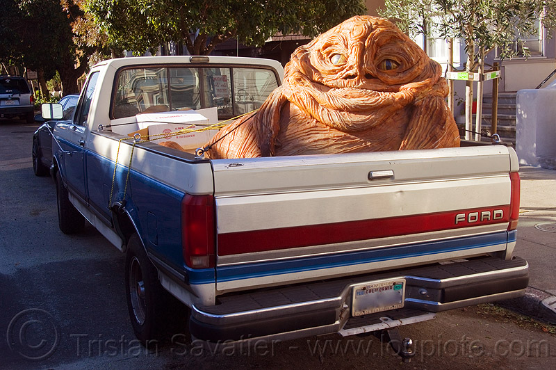 jabba the hutt in a pickup truck, character, giant muppet, special effects, starwars, street