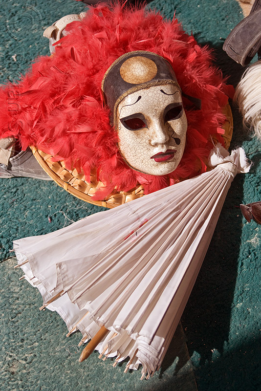japanese mask and umbrella, burning man, center camp, feather boa, japanese mask, japanese umbrella
